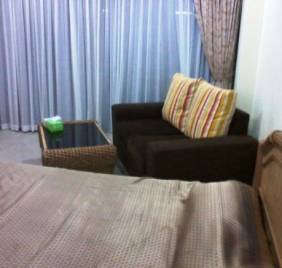 Room rental with sofa and coffee table