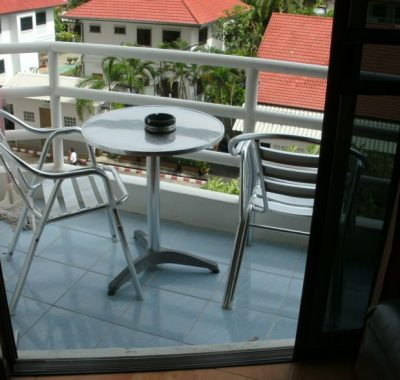Rental with balcony and chairs